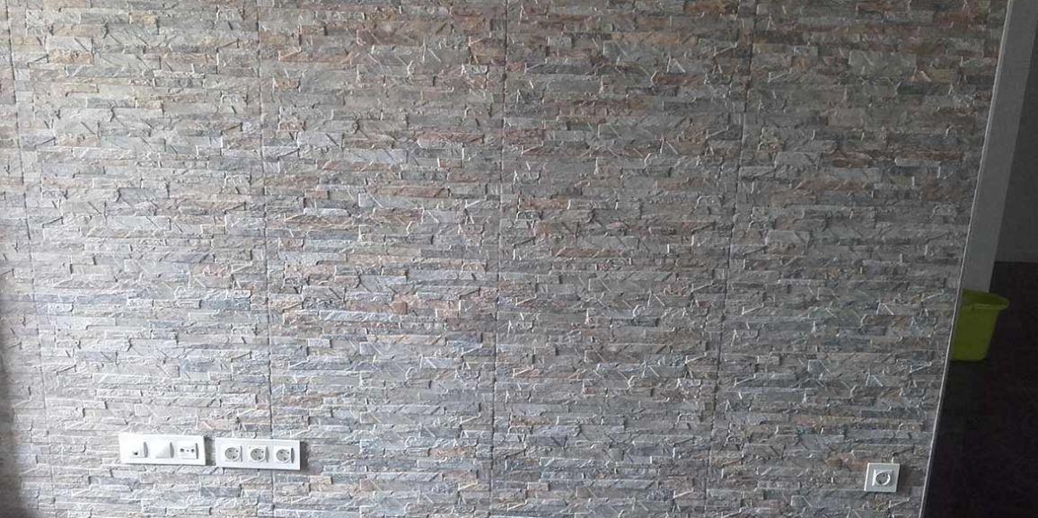 Reforma de comedor con pared decorativa tipo piedra